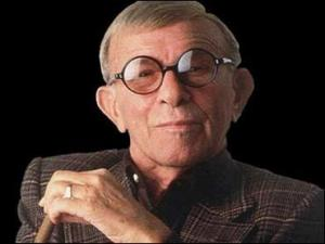 "George Burns, in the 1980s. Gracie died in 1964 at the age of 69, but Burns, like Hope, lived to be one hundred years old. He was interred with his wife, the crypt's marker reading ""Gracie Allen & George Burns --Together Again."""